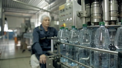 The control of a production line for bottling mineral water in bottles Stock Footage