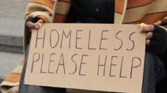 Adult man holding homeless please help sign, poverty, social vulnerability Arkistovideo
