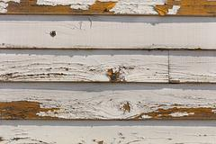 Old and fading paint peeling off of wood sliding - stock photo