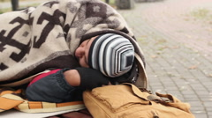 Pitiful homeless man sleeping on bench, social vulnerability, poverty, misery - stock footage