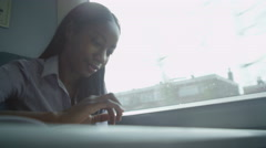 4K Tired young woman using computer tablet during train journey Stock Footage