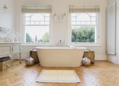 Home showcase interior bathtub and parquet floor - stock photo