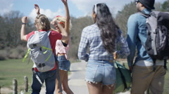 4K Hipster friends in the countryside going to festival or on a camping trip Stock Footage