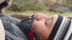 Poor ill male lying on bench and coughing, homelessness, misery. Close-up - stock footage
