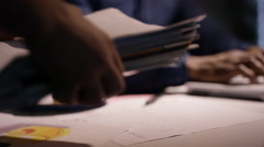 4K Overworked businessman working late is given extra pile of paperwork Stock Footage