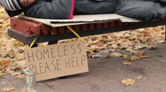 Charity, kind man leaving pack of money on bench while homeless male sleeps Stock Footage