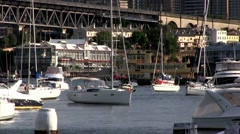 Sydney ferry on its daily route, with yachts moored in the foreground. Stock Footage