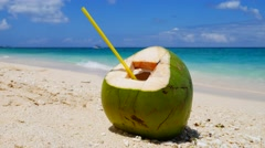 Ready to drink coconut on a sand of the tropical beach in UHD Stock Footage