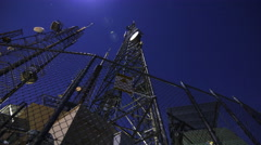 3axis MoCo Time Lapse of Broadcasting Radio Tower on Full Moon -Zoom In- Stock Footage