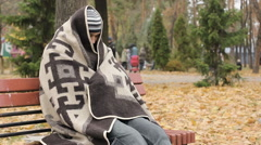 Pitiful jobless man sitting on bench in park, homelessness, social vulnerability Stock Footage