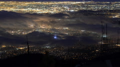 Time Lapse Overview of Foggy LA City Lights -Tilt Up- Stock Footage