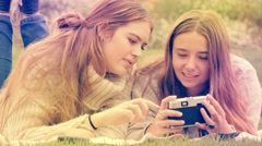 Taking photographs with old retro style film camera young woman taking selfie Stock Footage