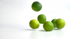 limes falling in slow motion - stock footage