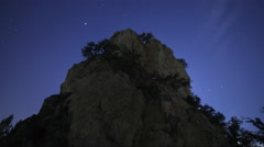 Astrophotography Time Lapse of Stars over Giant Boulder -Tilt Up- Stock Footage
