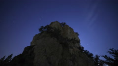Astrophotography Time Lapse of Stars over Giant Boulder -Zoom In- Stock Footage