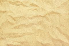 Top view of yellow beach sand texture, summer holiday background Stock Photos