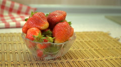 Appetizing strawberry in the bowl table top. Stock Footage