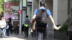 Shoppers walking on Shanghai Huaihai road Stock Footage
