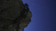 Astrophotography Time Lapse of Stars over Giant Boulder -Vertical- Stock Footage