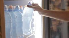 Woman take bottle of cold fresh mineral water - stock footage
