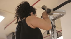Woman Doing Chin Up Assist with Weight Stack - stock footage