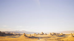 Time Lapse of Sunset over Desert Landscape in Trona Pinnacles -Tilt Up- Stock Footage