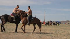 Two young men fighting on horseback Stock Footage