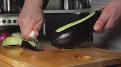 SLOW: Cook cleans a eggplant in a restaurant kitchen Stock Footage