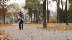 Mentally ill male wrapped in blanket walking in park, health problems, homeless Stock Footage
