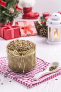 Sunflower Bread with crumbs, New Year Cloth, Teaspoons on White Table Stock Photos