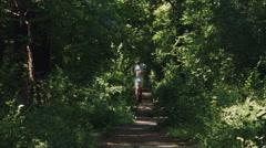 Man Running in forrest, park, woods, nature, marathon, sport, slow motion - stock footage