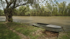 Old fishing boat on the river Stock Footage