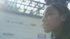 4K Beautiful young woman looking worried as she stands alone at railway station Stock Footage