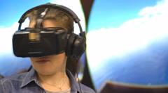 Virtual reality game. Girl uses head mounted display Stock Footage