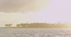 4K: Island Atoll At Sunset Shot From Boat - stock footage