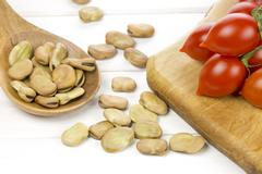 Broad beans and tomatoes - stock photo