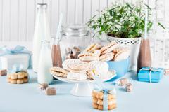 Baby shower in blue with sweets and milkshakes Stock Photos