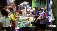 Bangkok market cooked food counter Stock Footage