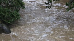 Medellin, Columbia, Circa 2016: Up tilt of flooding and white water rapids  - stock footage
