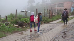 Medellin, Columbia, Circa 2016: Children walking down a misty road - stock footage