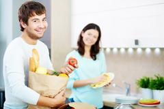 Healthy food for young couple Stock Photos