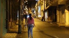 Medellin, Columbia, Circa 2016: A woman walking with a pink backpack  Stock Footage
