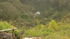 A ridge in the cloud forests of Colombia with a small gold mining shack at the - stock footage