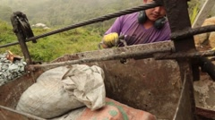 Medellin, Columbia, Circa 2016: Miners pulling out sacks from a box - stock footage