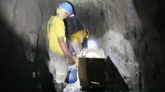 Medellin, Columbia, Circa 2016: Miners in a gold mine in Colombia shoveling Stock Footage