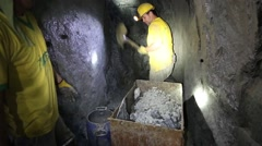 Medellin, Columbia, Circa 2016: Miners in a gold mine in Colombia shoveling - stock footage