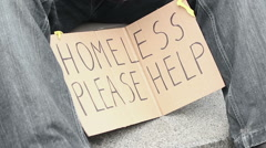 Wretched poor male begging for change, holding and shaking paper cup, homeless Stock Footage