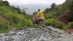 Medellin, Columbia, Circa 2016: Miner dumping rocks out of a mine cart Stock Footage