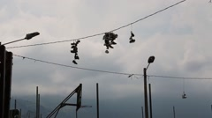 Pairs of shoes hanging on electrical wires in Medellin, Colombia Stock Footage