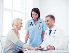 Doctor and patient in hospital Stock Photos
